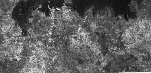The large dark patch seen on this image at high latitudes surrounding Titan's north pole, is from NASA's Cassini spacecraft's radar system, and most likely a hydrocarbon lake.