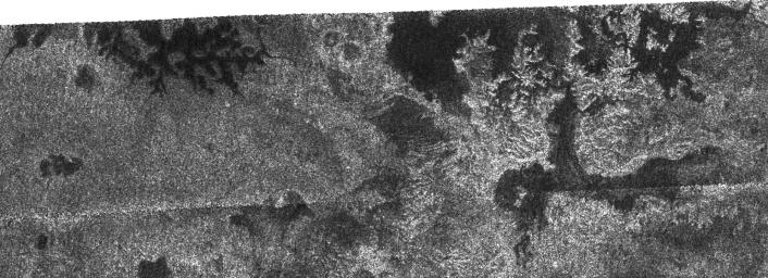 In this image taken by NASA's Cassini radar system, a previously unseen style of lakes is revealed. The lakes here assume complex shapes and are among the darkest seen so far on Titan.