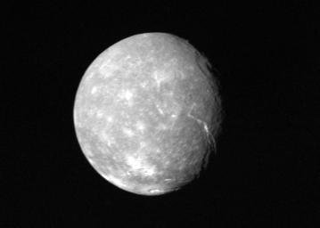 Voyager 2 obtained this full-disk view of Uranus' moon Titania in the early morning hours of Jan. 24, 1986, from a distance of about 500,000 kilometers (300,000 miles). Many circular depressions, probably impact craters, are visible in this clear-filter.