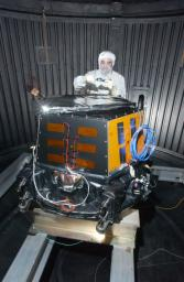 This image shows NASA's Deep Impact spacecraft being built at Ball Aerospace & Technologies Corporation, Boulder, Colo. On July 2, 2005. The impactor's S-band antenna is the rectangle-shaped object seen on the top of the impactor.