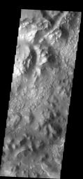 This type of 'broken-up' terrain is called chaos. At the bottom right corner of the image there is evidence of deposition of material.