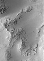 NASA's Mars Global Surveyor shows smooth, mantled surfaces, as well as bare, rocky surfaces on Mars.