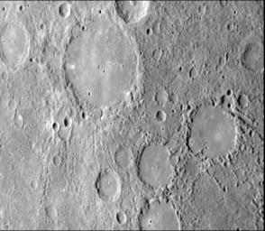 As NASA's Mariner 10 approached Mercury at nearly seven miles per second on March 29, 1974, its TV camera took this picture from an altitude of 35,000 kilometers (21,700 miles) The picture shows a heavily-cratered surface with many low hills.