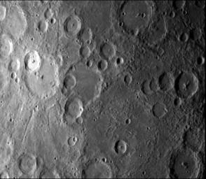 NASA's Mariner 10 took this picture some 2 1/2 hours before it passed Mercury on March 29, 1974. The bright-floored crater is the center of a very large bright area which could be seen in pictures from more than two million miles distant