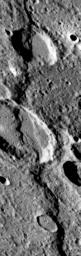 NASA's Mariner 10 spacecraft was coaxed into a third and final encounter with Mercury in March of 1975. This is one of the highest resolution images of Mercury acquired by the spacecraft. The prominent scarp snaking up the image was named Discovery Rupes.