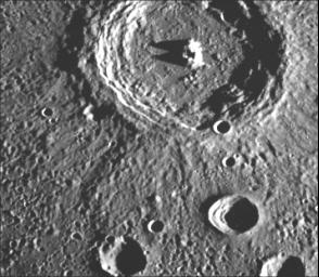 This crater illustrates the narrow hummocky rim facies, radial ridges, and surrounding extensive field of secondary craters. This image of Mercury was taken by NASA's Mariner 10.