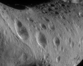 This image from NASA's NEAR Shoemaker shows the north polar region of asteroid Eros is heavily cratered but the region to the left (part of the 'saddle') has a lower crater density.