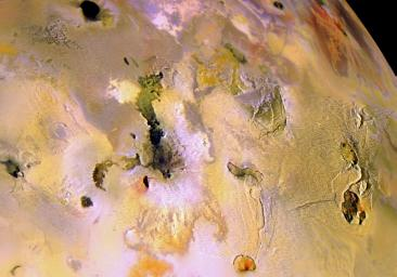 This picture of Jupiter's volcanic moon Io combines high-resolution black and white images taken by NASA's Galileo spacecraft on October 10, 1999, with lower resolution color images taken by Galileo on July 3, 1999.