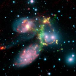 The false-color composite image of the Stephan�s Quintet galaxy cluster is made up of data from NASA's Spitzer Space Telescope and a ground-based telescope in Spain.