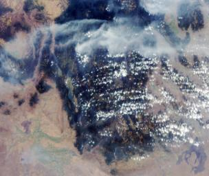 These images from NASA's Terra satellite are of smoke plumes from devastating wildfires in the northwestern U.S. This view of the Clearwater and Salmon River Mountains in Idaho was acquired on August 5, 2000 (Terra orbit 3370).