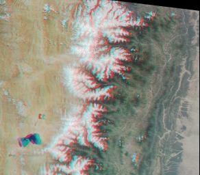 The Tibetan Plateau and a portion of the Himalayan Mountain chain are captured in this stereo image acptured by NASA's Terra satellite May 14, 2000 (Terra orbit 2153).