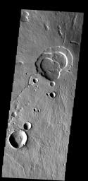 This image shows the summit of Hecates Tholus. The summit caldera is  located in the top of the image