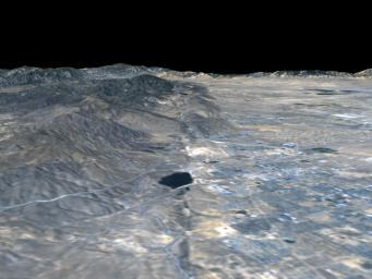 The prominent linear feature straight down the center of this perspective view is the San Andreas Fault. This segment of the fault lies near the city of Palmdale, CA (the flat area in the right half of the image) about 60 kilometers north of Los Angeles.