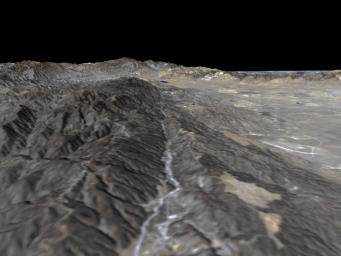 The prominent linear feature straight down the center of this perspective view is California's famous San Andreas Fault. The image was created with data from NASA's Shuttle Radar Topography Mission (SRTM).