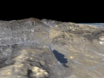 The prominent linear feature straight down the center of this perspective view is the San Andreas Fault in an image created with data from NASA's shuttle Radar Topography Mission (SRTM).