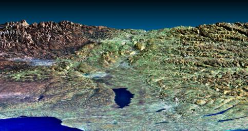 This perspective view from NASA's Shuttle Radar Topography Mission of upstate New York shows Lake Ontario in the lower left, the Adirondack Mountains in the upper left, and the Catskill Mountains on the right.