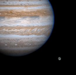 Jupiter casts a baleful eye toward the moon Ganymede in this enhanced-contrast image from NASA's Cassini spacecraft.