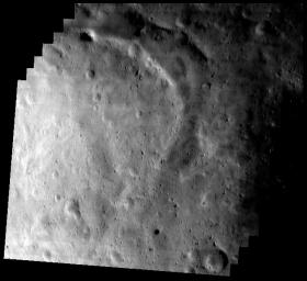 This image of asteroid Eros, taken by NASA's NEAR Shoemaker on May 17, 2000, shows the southern part of Eros' saddle with a wide, curved trough and bright area in the lower left section.
