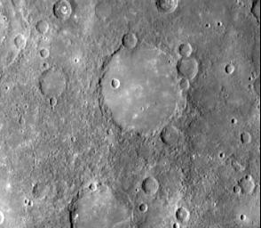 This image, from NASA's Mariner 10 spacecraft which launched in 1974, shows an old basin's hummocky rim is partly degraded and cratered by later events.