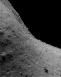 This image of asteroid Eros, taken by NASA's NEAR Shoemaker on July 22, 2000, shows the relatively gentle topography of the area really lies on a steep cliff.