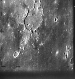 The dark flat floor of Mare Nubium on Earth's Moon dominates most of the image taken by NASA's Ranger 7 on July 31, 1964.
