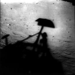 Image of Surveyor 1's shadow against the lunar surface in the late lunar afternoon, with the horizon at the upper right. Surveyor 1, the first of the Surveyor missions to make a successful soft landing, proved the spacecraft design and landing technique