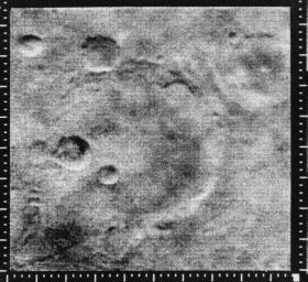 This image from NASA's Mariner 4 shows the crater named after it. A linear ridge runs through the bottom of the crater which is part of Sirenum Fossae on Mars.