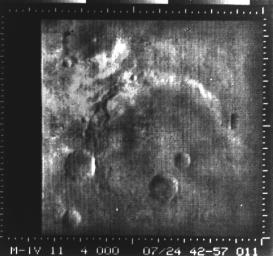 This image from NASA's Mariner 4 shows a crater in the Atlantis region. Mariner 4 revealed Mars to have a cratered, rust-colored surface.