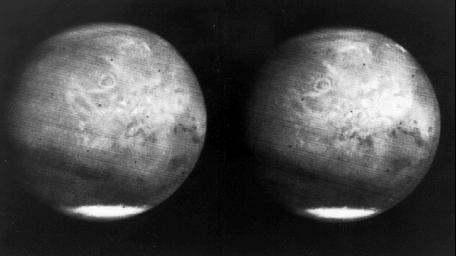 This image from NASA's Mariner 7 shows NIX Olympia (later identified as the giant shield volcano Olympus Mons), and polar caps on Mars.