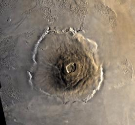 Color mosaic of Olympus Mons volcano on Mars from the Viking 1 Orbiter. The mosaic was created using images from orbit 735 taken 22 June 1978. Olympus Mons is about 600 km in diameter and the summit caldera is 24 km above the surrounding plains.
