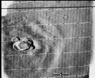 This image from NASA's Mariner 9 taken on Dec. 17, 1971 is a view of a complex crater on the summit of 'north spot' volcano, Ascraeus Mons