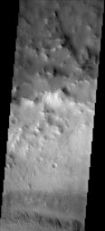 NASA's 2001 Mars Odyssey spacecraft shows that the dust avalanches found on this crater rim have exposed darker rocky material on an otherwise dust coated slope. This unnamed crater is located east of Schiaparelli Crater.