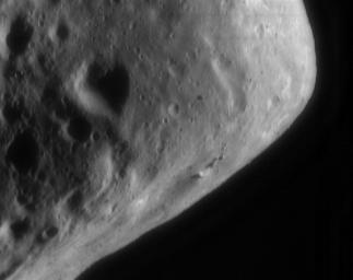 This image of asteroid Eros, taken by NASA's NEAR Shoemaker on Sept. 9, 2000, shows several long ridges and a cluster of boulders. The eastern end's blocky, angular appearance likely results from large impacts suffered by Eros early in its history.