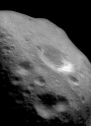 This image of asteroid Eros, taken by NASA's NEAR Shoemaker on Nov. 28, 2000, shows several key indicators of the battering Eros' surface has sustained over the eons. Most obvious are the countless craters.