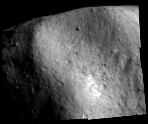This image of asteroid Eros, taken by NASA's NEAR Shoemaker shows the boulder-filled, concave depression at the southwestern edge of the saddle-shaped Himeros.