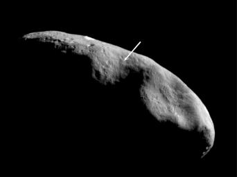 This image of peanut-shaped asteroid Eros, taken by NASA's NEAR Shoemaker on Dec. 3, 2000, shows the terminator (the imaginary line dividing day from night) which lies near the equator.