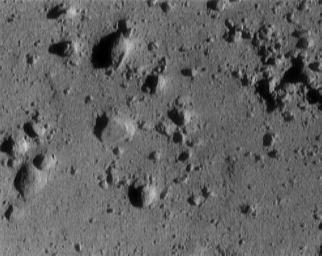 This image of asteroid 433 Eros, taken by NASA's NEAR Shoemaker shows a cluster of rocks at the upper right measuring 1.4 meters (5 feet) across.