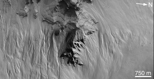 NASA's Mars Global Surveyor shows gullies on the pit walls of the Noachian Highlands on Mars.