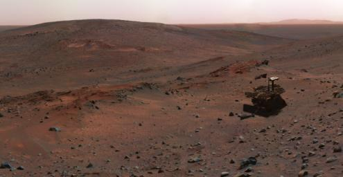 This synthetic image of NASA's Spirit Mars Exploration Rover on the flank of 'Husband Hill' was produced using 'Virtual Presence in Space' technology.