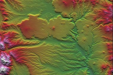 The interplay of volcanism, stream erosion and landslides is evident in this Shuttle Radar Topography Mission view of the eastern flank of the Andes Mountains, southeast of San Carlos de Bariloche, Argentina.