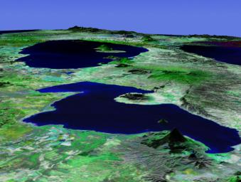 This perspective view acquired by NASA's Shuttle Radar Topography Mission from data collected in the year 2000 shows Lakes Managua and Nicaragua near the Pacific coast of Nicaragua.