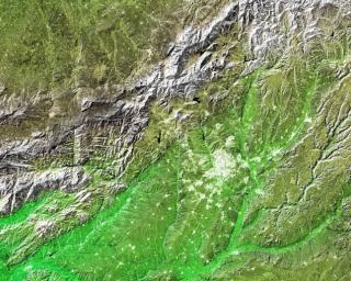 The white, mottled area in the right-center of this image from NASA's Shuttle Radar Topography Mission is Madrid, the capital of Spain.