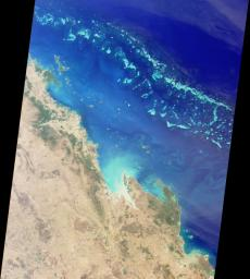 The Great Barrier Reef extends for 2,000 kilometers along the northeastern coast of Australia. It is not a single reef, but a vast maze of reefs, passages, and coral cays (islands that are part of the reef).