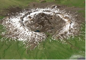 This image is a perspective view acquired by NASA's Airborne Synthetic Aperture Radar (AIRSAR) in 2001, is of Umnak Island, one of Alaska's Aleutian Islands. The active Okmok volcano appears in the center of the island.