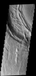 This image from NASA's 2001 Mars Odyssey spacecraft shows part of the caldera rim of Nili Patera. Dunes are located within the caldera.