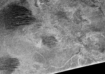 Synthetic aperture radar images obtained from NASA's Cassini spacecraft in February 2005 show that Titan's surface is modified by fluid flows and wind-driven deposits.