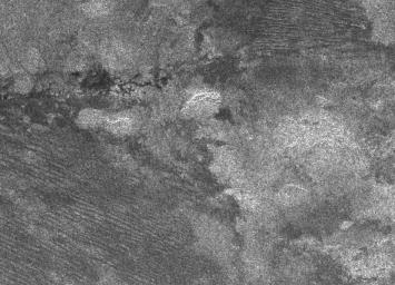 The geologic diversity of Titan's surface is well illustrated by this synthetic aperture radar image, obtained on Oct. 28, 2005, during NASA's Cassini spacecraft's ninth Titan fly-by and fourth radar pass.