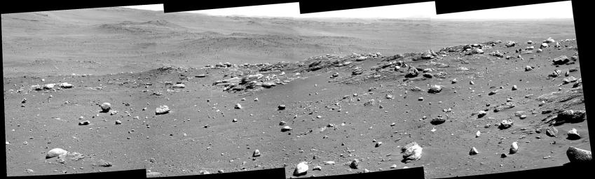 This view combines four frames from Spirit's panoramic camera, looking in the drive direction on the rover's 680th Martian day, or sol (Dec. 1, 2005). 'Algonquin' is the information name given to the outcrop of apparently layered bedrock.