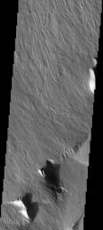 This image shows the massive Olympus Mons flows at the basal escarpment