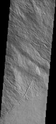 This image shows part of the flank and margin of Ascraeus Mons